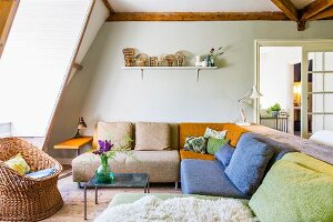 Comfortable corner couch in various colours in attic room