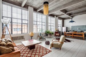 Ribbed concrete ceiling and white wooden floor in eclectic loft apartment