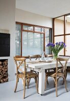 White wooden table and coffee-house chairs in dining room