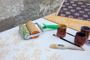 Pattern paint roller, paintbrush, ceramic pots and various pattern samples