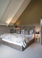 Attic bedroom in shades of grey