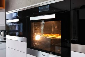 A built-in, illuminated oven