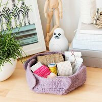 A homemade crocheted basket made from felting wool
