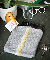 A homemade knitted tablet cover made from felting wool