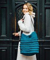 A hand-crocheted handbag made of felting wool
