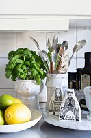 Marble kitchen utensils, basil and whimsical salt and pepper shakers