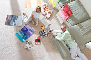 Couple looking at colour sample on floor