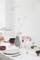 Table set with wooden bowls and lamp-bulb lamp on wall