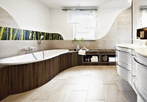 An organically designed bathroom with built-in furniture, shelves and a wall decorated with a floral photo panel