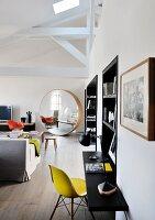 Large round designer mirror in lounge area