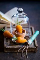 Marzipan carrots with rosemary leaves