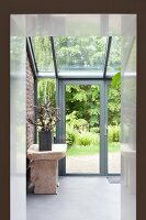 View through doorway of stone bench in conservatory extension