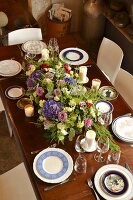 Table set with various plates and flower arrangement