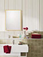 Beige-coloured striped non-woven wallpaper and tiled facing with a shelf in a bathroom
