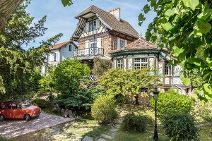 Traditional half-timbered house with Oriental elements in summery surroundings