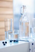 Glasses and carafes of water with blueberries