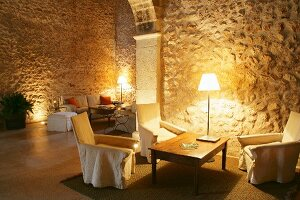Mediterranean living room with stone walls