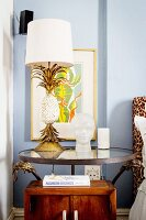 Table lamp with pineapple-shaped base on bedside tabe