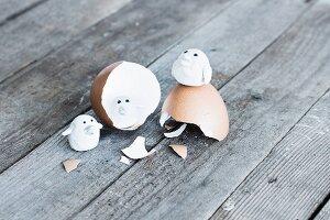 Tiny polymer clay birds on egg shell