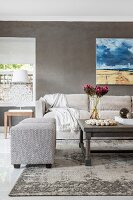 Landscape painting on grey wall in elegant living area