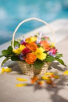Bouquet of spring flowers in wicker basket