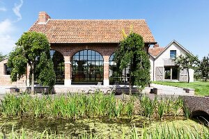 Brick house with huge arched windows on country estate