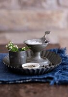 Candlestick used as salt cellar on flan tin used as tray