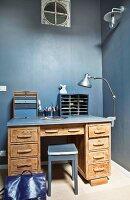Desk against grey-blue wall