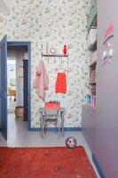 Bird-patterned wallpaper in girl's bedroom