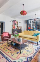 Ethnic rug and leather armchair in retro living area