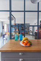 View from kitchen through glass partition in retro, open-plan interior