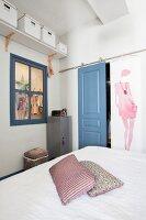 Wardrobe in niche with dove-grey sliding door in feminine bedroom
