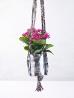 Macrame plant hanger made from jersey yarn and a tin can