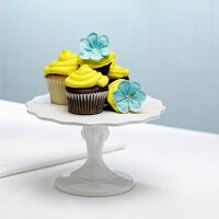 Chocolate and vanilla cupcakes with yellow icing