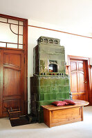 Green tiled stove with wooden bench