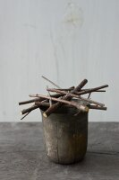 Flower stand made from twigs and wire on vintage pot