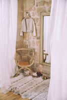 Cosy dressing room with exposed stone wall and rug