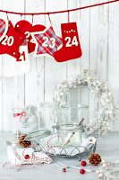 Christmas decorations and preserving jars on white table
