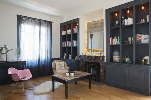 Dark fitted cupboards and fireplace in living room