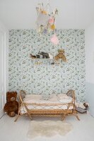 Vintage-style floral wallpaper and rattan bed in child's bedroom