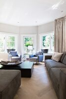 Window bay flooded with light in elegant living room