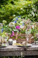 Lavish bouquet of wildflowers in wooden crate decorating table
