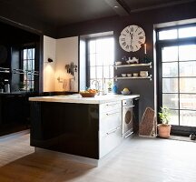 Black glossy cabinets and white floor in kitchen