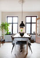 Long wooden table and metal chairs in vintage-style dining room