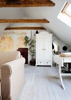 Mural in stairwell leading to attic room with wooden roof beams