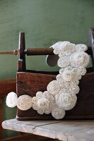 Collar of white rosettes embroidered with seed beads