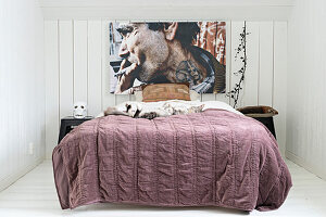 Picture of smoking man above bed in small bedroom