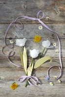 Paper tulips and flowers on wooden boards