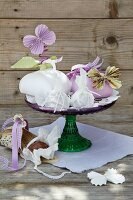 Card gift boxes and paper butterflies on cake stand