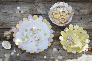 Pastel paper baskets and Easter eggs decorated with paper flowers